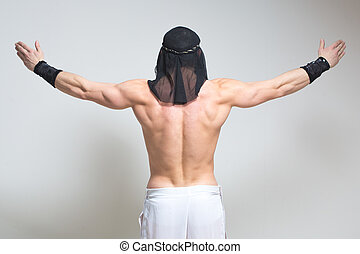 Arabic man posing. sexy bodybuilder on a white background