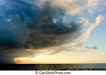 Sunset Ocean Storm Clouds - Sunset ocean storm clouds is a...