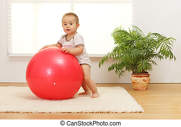 Baby boy with big red ball - Little baby boy playing with...