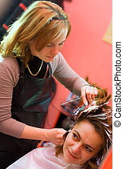 Hair-stylist - Womans hair being painted at the hair stylist...