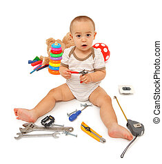 Little boy with tools - Little boy sitting and playing with...