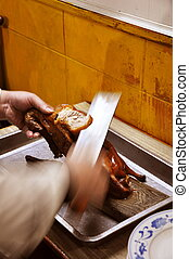 Peking Duck - Chef preparing a Peking/Bijing duck