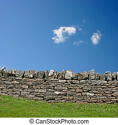 Stone Wall - A Stone Wall with Blue Sky and Clouds