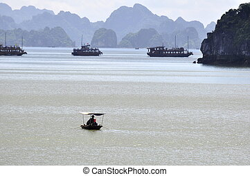 Fishermen in Halong Bay - Fishermen rowing at Halong Bay