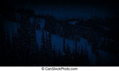 Moving Down Mountain In Snowstorm At Night - Aerial shot...