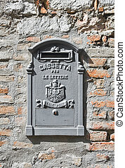 Postbox on brickwall.