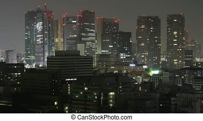 Time lapse Tokyo skyline at night Lights in windows...