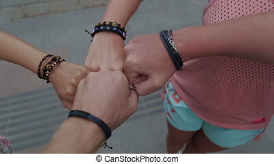 young hands folded on one another showing friendship