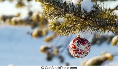 Merry Christmas and Happy New Year. Glass toy on the tree