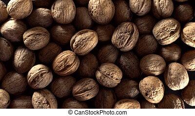 Walnuts in rotation. - Walnuts in rotation on black...