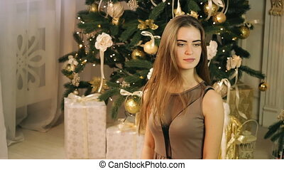 Beautiful woman catching box with christmas gift and...