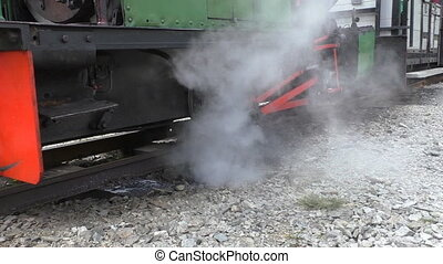 Steam locomotive engine - Close up of water and steam...