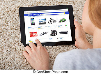 Woman Using Digital Tablet - Close-up Of A Young Woman Using...