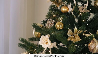 Beautiful woman decorate Christmas tree with beauty toys and...