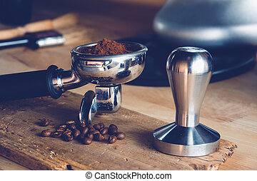 coffee - Freshly ground coffee beans in a metal filter on a...