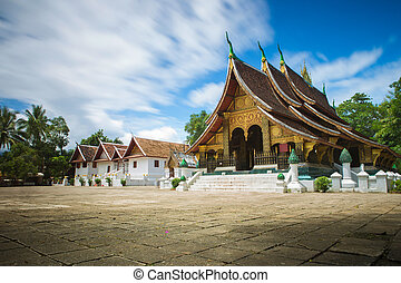 laos - Xieng Thong Temple with blue sky and cloud flowing in...