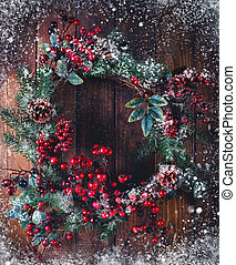 Christmas wreath decoration with pine cones and hawthorn...