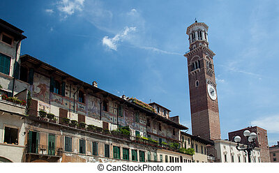 Lamberti tower in Verona - Old painted buildings in Erbe...
