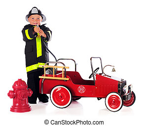 Fireman Hosing - A preschool boy by a fire truck and hydrant...