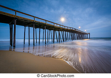 Waves in the Atlantic Ocean and the fishing pier at...