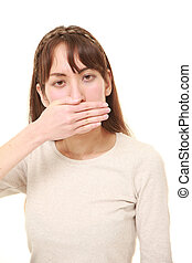 woman making the speak no evil gesture