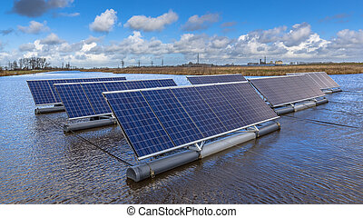Close up of Group of Photovoltaic panels floating on water -...