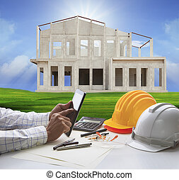 hand of architect working on computer tablet and house...