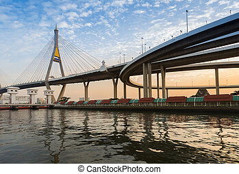 Suspension bridge over watergate at sunset, Bangkok Thailand