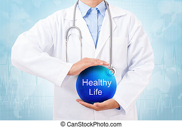 Doctor holding blue crystal ball with Healthy Life sign on...