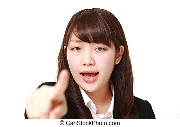 young Japanese businesswoman scolding - studio shot of young...