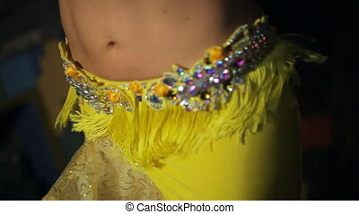 Magic belly dance from beautiful brunette, close-up shot....