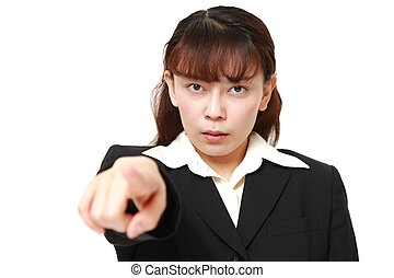 Asian businesswoman scolding - studio shot of Asian...