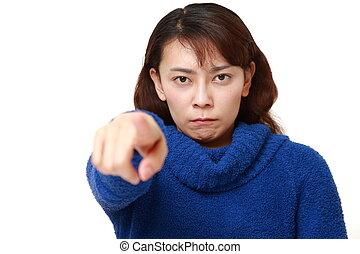 Asian woman scolding - studio shot of Asian woman on white...