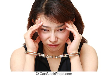 studio shot of arrested woman - concept shot of Asian woman...