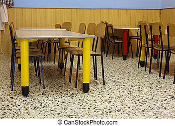 tables and colored chairs in a nursery school - refectory...