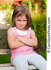 Child portrait - offended - Outdoors portrait of small cute...