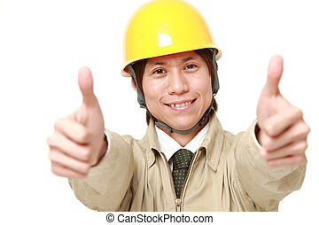 construction worker with thumbs up gesture - studio shot of...