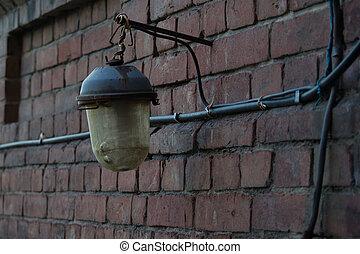 old lantern on a brick wall