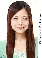 young Japanese woman smiles