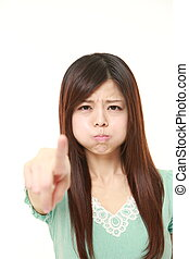 young Japanese woman scolding - portrait of young Japanese...