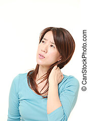 middle aged Japanese woman suffers from neck ache - studio...