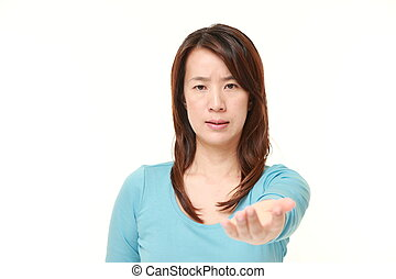middle aged Japanese woman scolding - studio shot of middle...