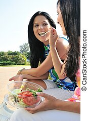 Friends having great time when eating outdoors