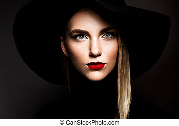 Woman with red lips and black hat