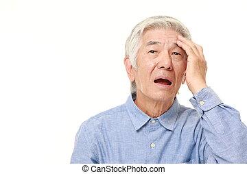 senior Japanese man has lost his memory - studio shot of...