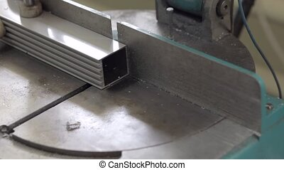 aluminium profile cutting machine with man's hands