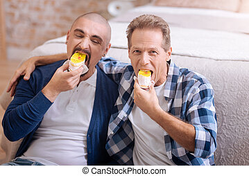 Pleasant non-traditional couple eating cake together - We...