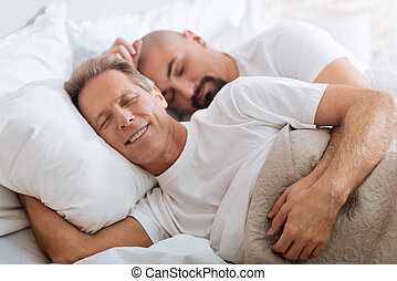 Pleasant non-traditional couple sleeping together - We...