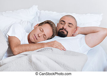 Peaceful non-traditional couple sleeping together - We...