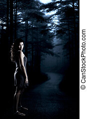 Girl in the forest - Beautiful girl at night in the middle...